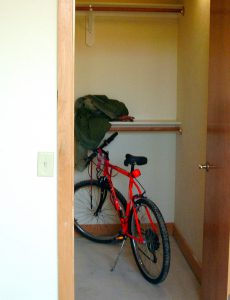 A condo owner storing a bike in the unit could be fined for wheeling it through an undesignated common area or over a finished floor. Check the condo docs first.
