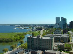 A three-way view from a Milwaukee Gold Coast condo, encompassing both lake and city views to the east, south, and west.