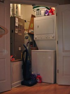 In-unit laundry room with double doors